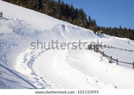 Winter road in mountains in Carpathians