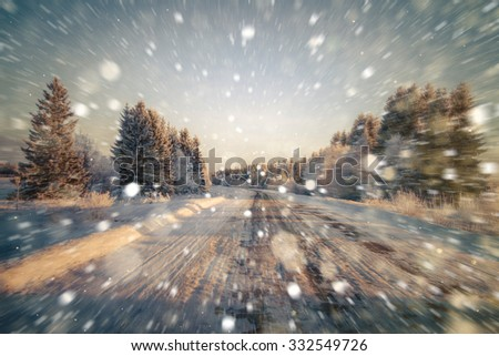 Winter road, sweeping the road, motion blur. Rain, snow, snow turns on the road. Winter background. Copy space.