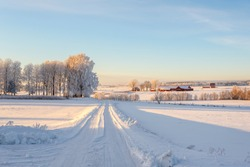 Winter road with snow in the countryside