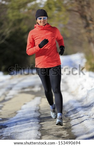 Winter running exercise woman Healthy lifestyle active woman concept