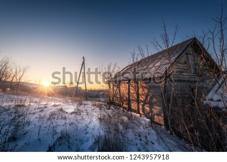 winter russia barn old house footprints in the snow morning dawn #1243957918