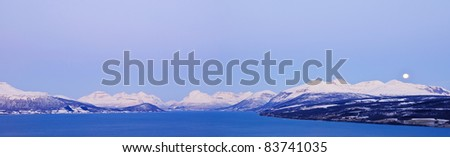 Winter's Tale.Panorama. Norway. Fjords, houses, lights, polar night