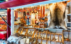 Winter Saami Souvenirs such as reindeer fur and horns at Finnish Christmas Market in Rovaniemi, Finland, Lapland. Street Xmas holiday fair. Advent Decoration and Stalls with Crafts Items on Bazaar