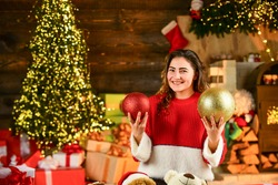 Winter sale. Celebrate holiday. Holiday tradition. Decorate home. Xmas spirit. Santa is near. Happy girl at christmas tree. Family holiday celebration. Happy new year. Woman enjoy cozy atmosphere.