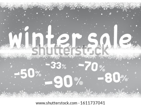 Winter sale text with falling discounts symbols and snow. Seasonal discount sign