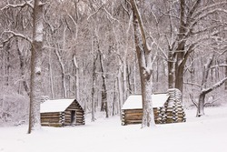 Winter scene, log cabins at Valley Forge National Historic Site.
