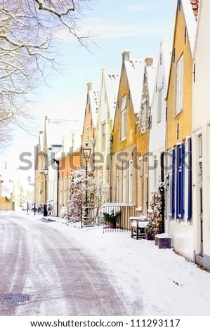 winter scene of a little village in holland, europe