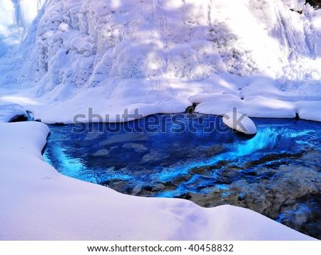 Winter scene of a running creek through snow covered johnston canyon, banff national park, alberta, canada