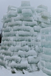 Winter scene with ice sculptures made from frozen blocks of lake water in the Adirondacks at Saranac Lake New York