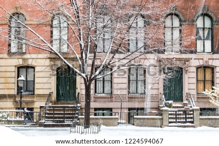 Winter scene with snow covered sidewalks along Stuyvesant Street in the East Village neighborhood of New York City