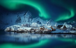 Winter scenery with aurora over Reine. Incredible winter view on snowcapped mountains, fishing village and Northern lights. Typical nature landscape of Lofoten islands. Norway. creative poscard