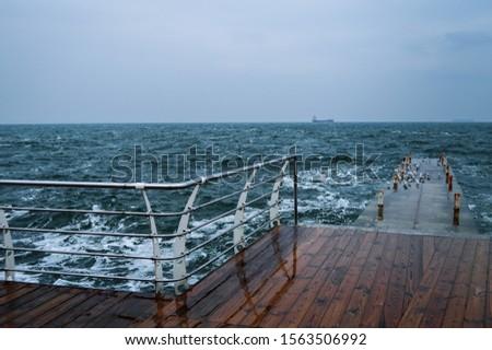 Winter sea. Storm in the sea. Blue sea