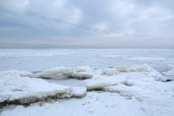 Winter seaside landscape - beach and frozen Baltic Sea near Mikoszewo, Zulawy Wislane, Poland