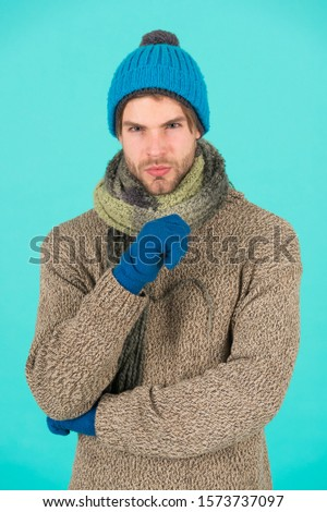 Winter season sale. Hipster knitted winter hat scarf and gloves. Casually handsome. Man handsome unshaven guy wear winter accessories on blue background. Shopping concept. Emotional expression.