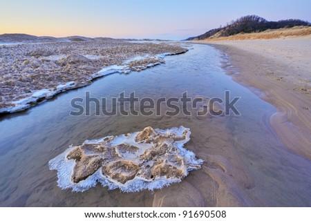 Winter shoreline of Lake Michigan at twilight, Saugatuck Dunes State Park, Michigan, USA