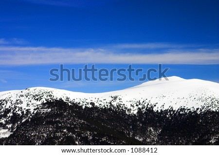 Winter simple landscape with snow-covered mountains