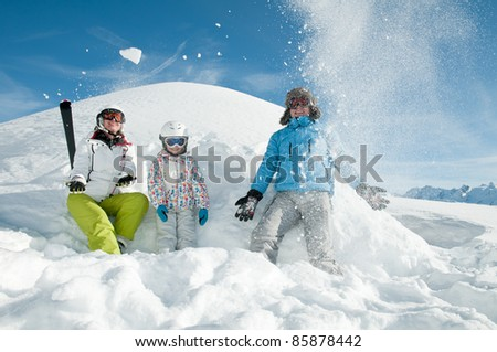 Winter, ski - family playing in snow