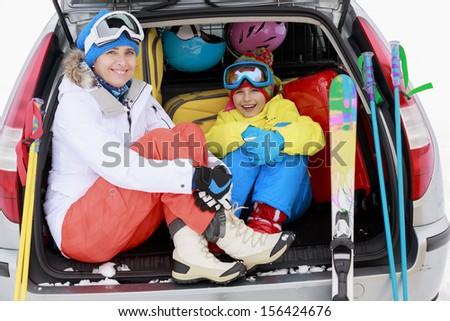 Winter, ski, journey - family with ski equipment ready for travel to ski resort