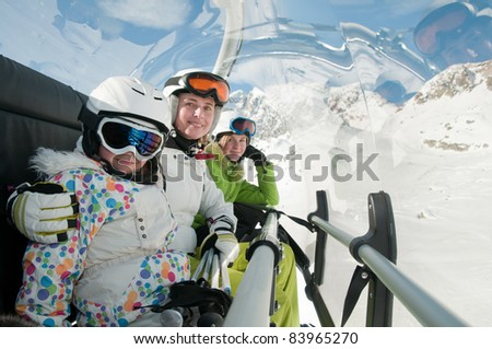 Winter, ski lift - family on ski vacation