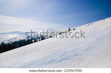 WInter ski resort snow mountains landscape with blue sky in summer sunny day