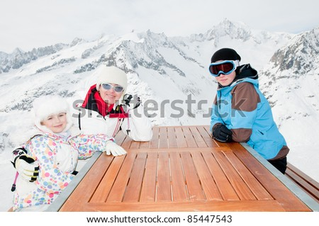 Winter, ski - skiers waiting for lunch