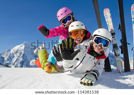 Winter, ski, snow and fun  - family enjoying ski holiday