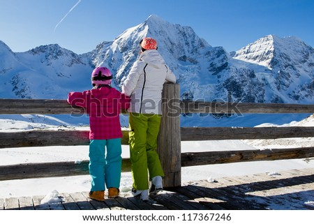 Winter,ski, snow and sun - family enjoying winter vacation