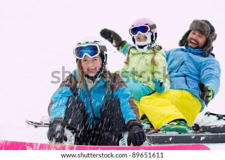 Winter, ski sun and fun - happy skiers playing in snow