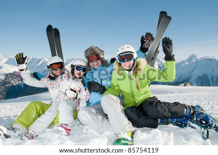 Winter skiing happy family in ski resort