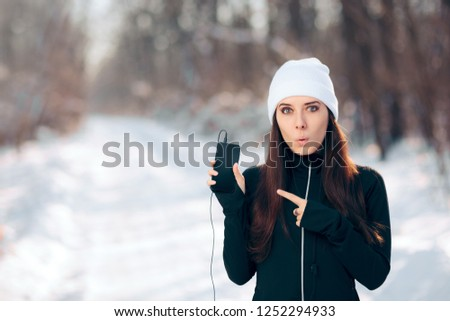 Winter Smartphone Girl Listening to Music Radio Using Earphones. Athletic woman ready to exercise on her favorite songs playlist  #1252294933