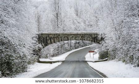 Winter Snow at Holloway Mountain Road entrance for Blue Ridge Parkway, North Carolina #1078682315