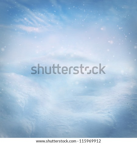 Winter snow background. Snow on the hills with blue sky in the back.
