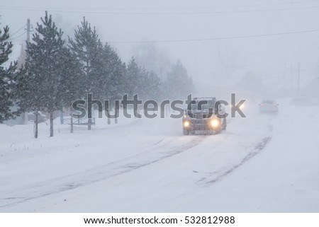 Winter, snow, Blizzard, poor visibility on the road. Car during a Blizzard on the road with the headlights.   #532812988