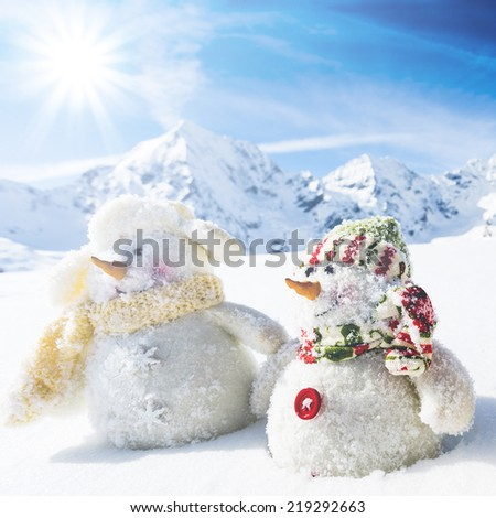 Winter, snow, Christmas - happy snowman friends and snowy mountains in background