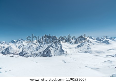 Winter snow covered mountain peaks in Caucasus. Great place for winter sports #1190523007