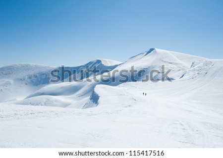 Winter snow covered mountain peaks in Europe. Great place for winter sports #115417516