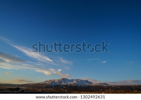 Winter snow-covered mountains and blue sky of Iceland