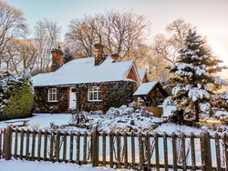 Winter snow covered village cottage in England