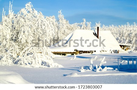 Winter snow covered village hut view. Winter snow village hut
