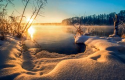 Winter snow forest lake sunset landscape. Sunset winter forest lake view. Sunset winter forest lake fog. Sunset lake fog in winter snow forest scene