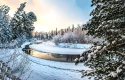 Winter snow forest river landscape. Sunset winter forest river view. Winter snow forest river. Winter forest river snow