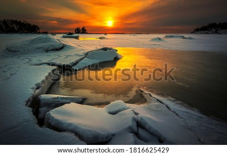 Winter snow frozen lake at sunset. Winter snow sunset lake. Frozen lake in winter snow sunset. Sunset winter snow lake landscape