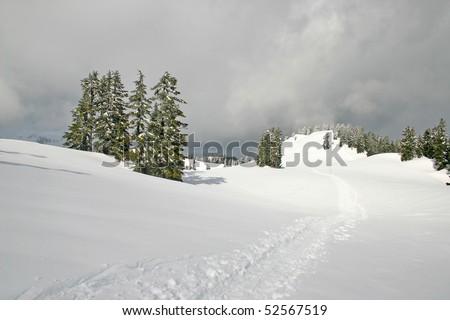 Winter snow hiking view on mountain peak.
