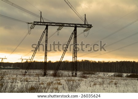 Winter snow landscape with electric lines