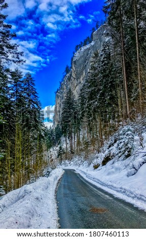Winter snow mountain forest road. Road in winter mountain forest. Mountain road in winter snow forest