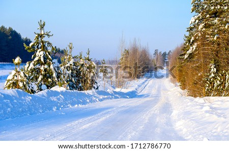 Winter snow rural road landscape. Winter snow road. Rural winter snow road. Rural snow winter road landscape