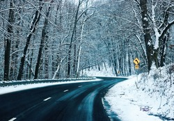 Winter Snow Storm on a Curvy Road with Snow Covered Trees Dark