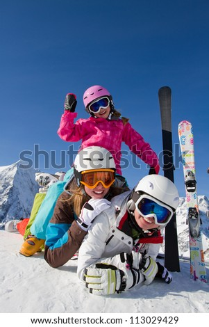 Winter, snow, sun and fun - family enjoying winter vacations ( space for text)