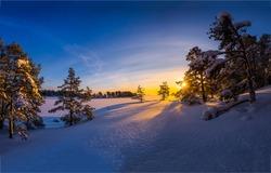 Winter snow sunrise nature landscape. Snowy winter sunrise outdoors. Winter sunrise in nature snow. Winter snow sunrise landscape