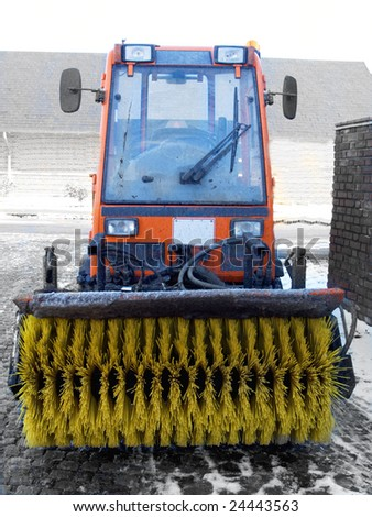 Winter - Snow sweeper tractor in  Denmark - stock photo
